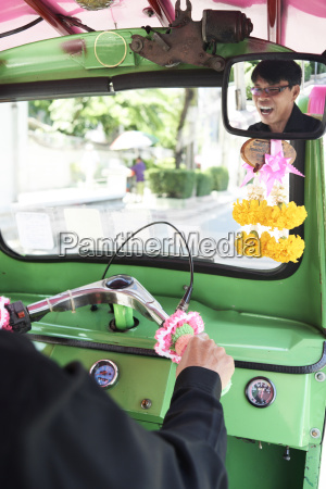 thailand bangkok driver having fun in