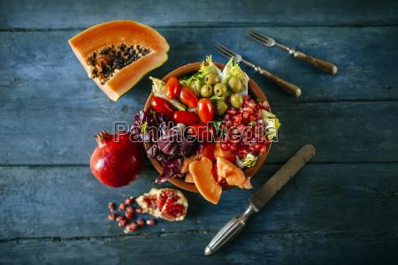 papaya salad pomegranate lettuce tomato olives