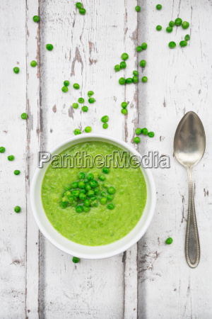 bowl of pea soup spoon and
