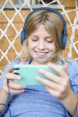portrait of happy girl with headphones