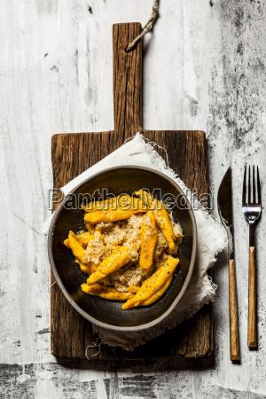 pumpkin schupfnudeln with sauerkraut in bowl