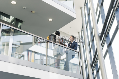 businessman and woman talking on office