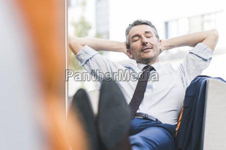 portrait of businessman relaxing in lounge