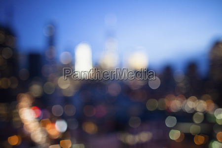 defocused image of illuminated cityscape at