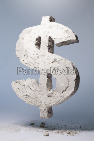 dollar sign made of stone material