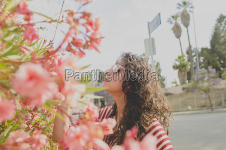 mid adult woman standing by pink