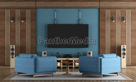 home cinema room with tv hanging