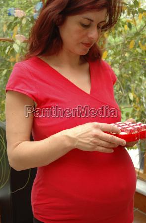 pregnant woman nibbles chocolates
