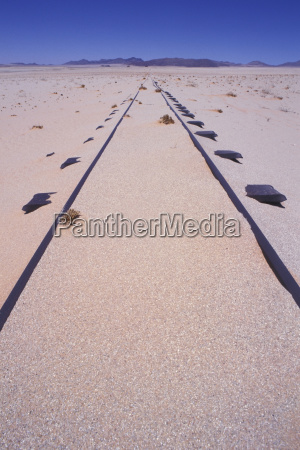 old train track in the sand