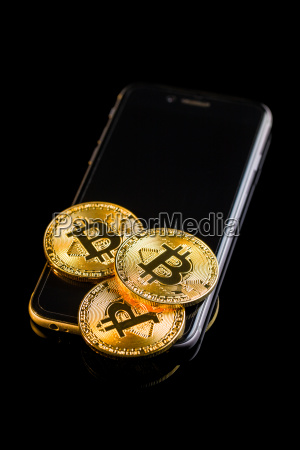 bitcoin lies on a smartphone