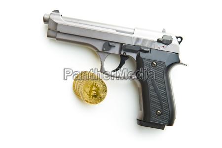 golden bitcoins cryptocurrency and handgun