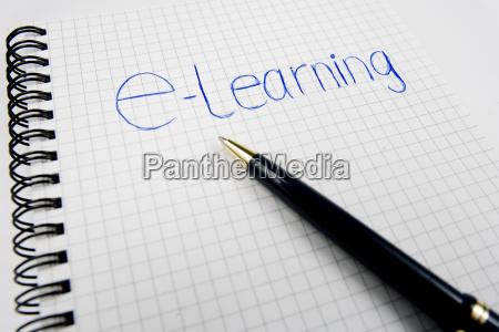 notizblock mit kugelschreiber und dem schriftzug