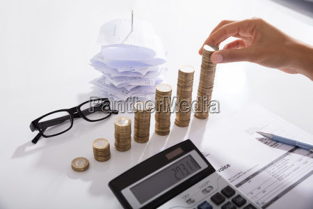 accountant stacking coins