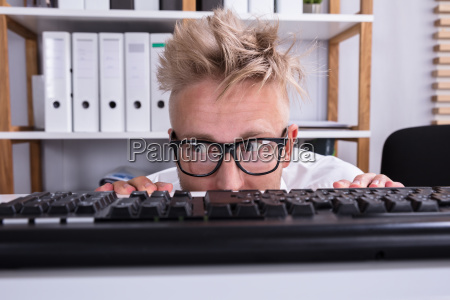 funny businessman hiding behind desk
