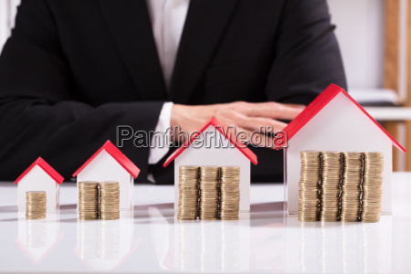 coins and different sizes house model