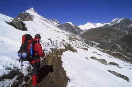 woman is hiking at machermo nepal