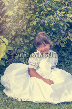 vintage photo of little girl sitting