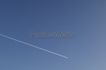 contrails of a passing aircraft