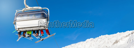 skiers and snowboarders in a ski