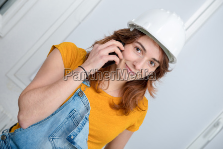 young engineer woman with safety hard