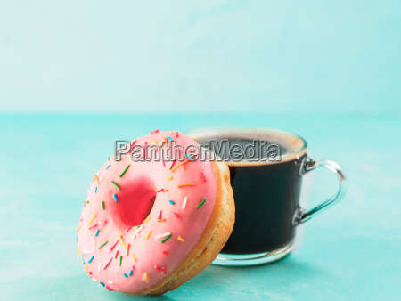 pink donut and coffee on blue