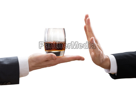 businessperson reject a glass of whiskey