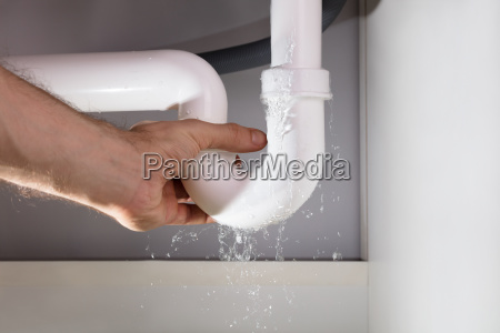 male hands holding the white sink