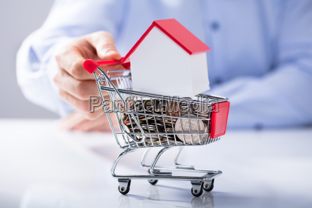 man holding shopping cart filled with