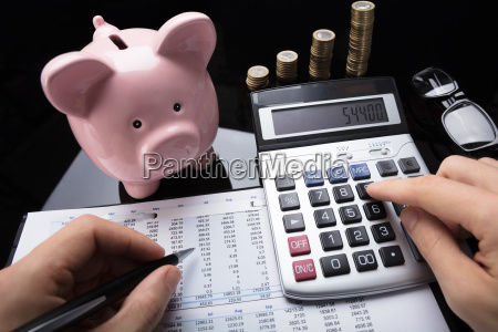 businessperson calculating financial data with calculator