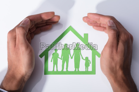 person protecting family home