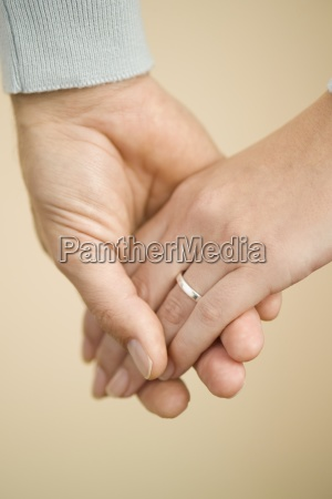 husband and wife holding hands