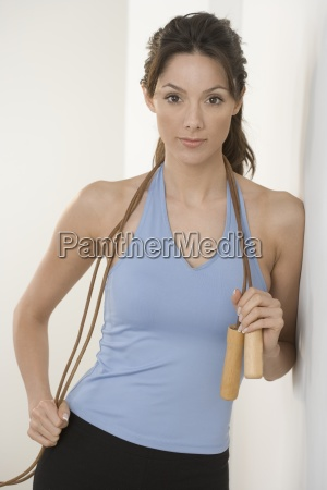 woman with jump rope leaning on