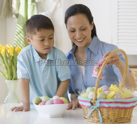 asian mother and son making easter