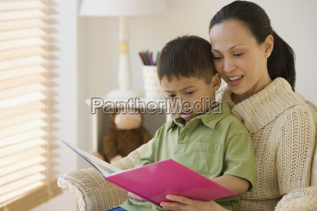 asian mother reading to son