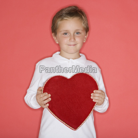 boy holding heart shaped box