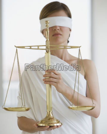 blindfolded woman holding scales