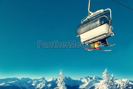 people in chairlift at ski resort