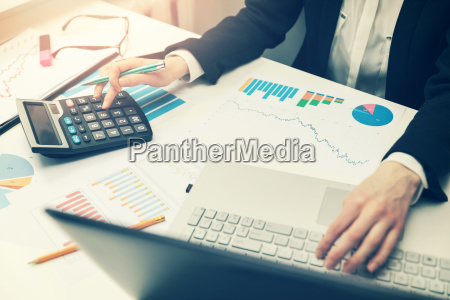 woman working with business reports in