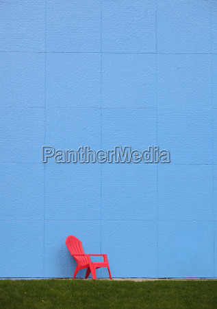 red chair by blue wall