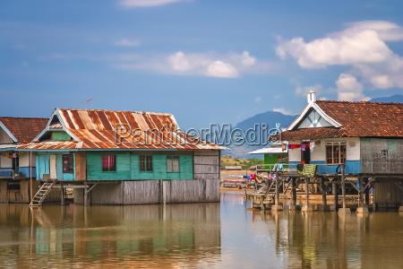 villagers homes on stilts in sumbava