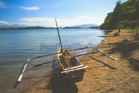 wooden fishing pirogue on the beach