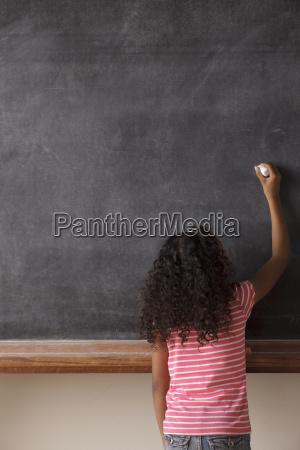 portrait of schoolgirl 10 11 writing