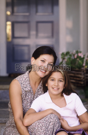 mother and daughter sitting in front