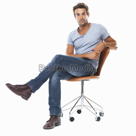 portrait of young man sitting on