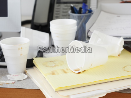 messy office desk with empty disposable