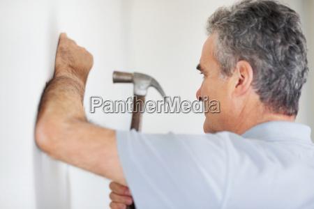 man using a hammer