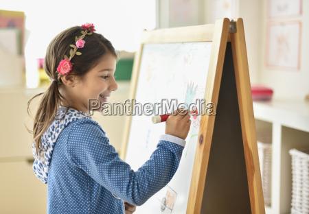 girl 6 7 writing on board