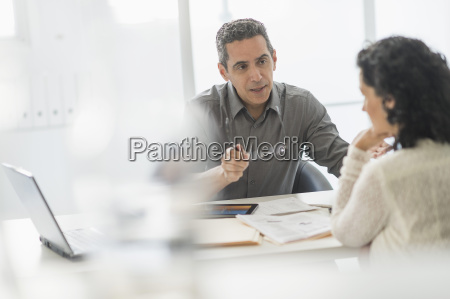 business people talking at desk in