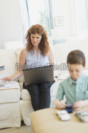 mother using laptop son 6 7