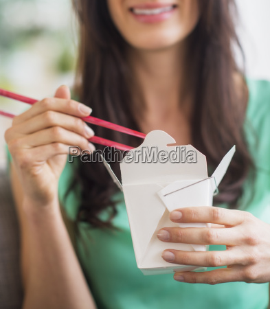 portrait of woman eating take out